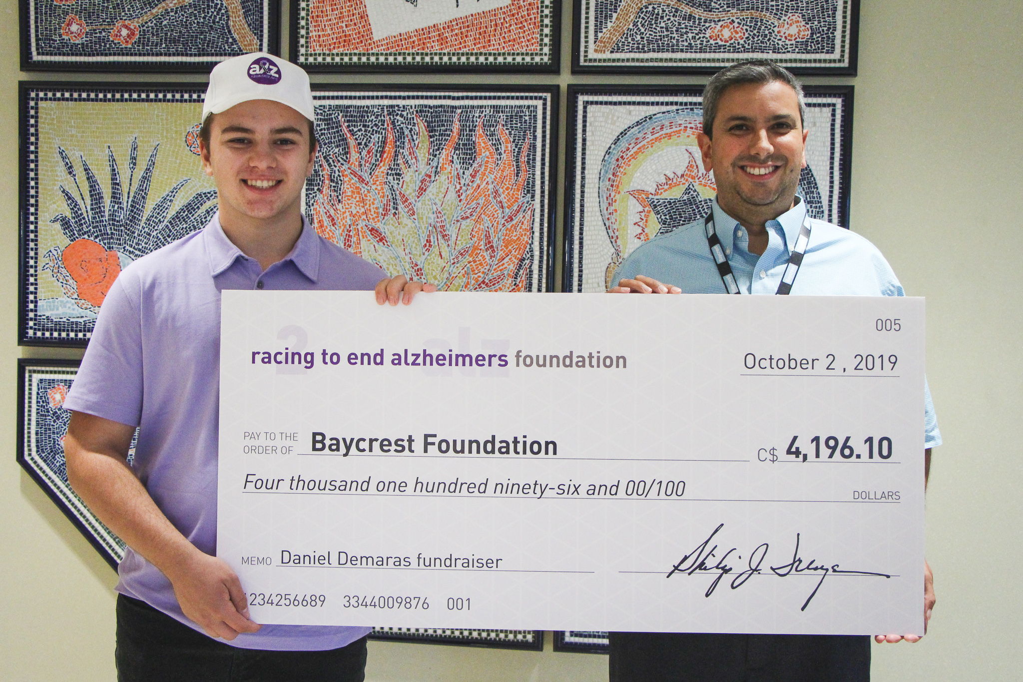 Daniel Demaras and Craig Sharma with cheque